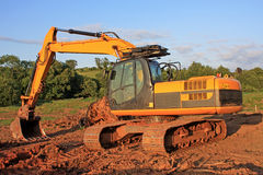 Digger. On a road construction site stock photography