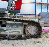 Digger on sand. Close-up of digger on sand, living quarters in background Stock Images