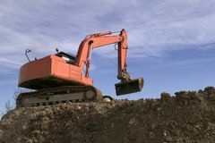 Digger in the sky Royalty Free Stock Images