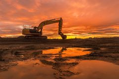 Digger At Sunrise. One larger digger park up waiting for anothers days work Stock Photography