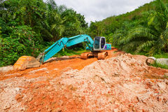 Digger in the tropical jungle Stock Photo