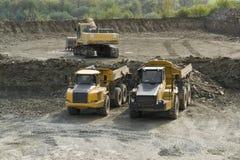 Digger and trucks Stock Photos