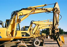Diggers. Yellow diggers in line Stock Photography