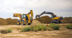Diggers. Doing excavation work in the desert Royalty Free Stock Photos