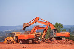 Diggers and Dump Truck. Diggers working on a construction site Stock Photo