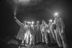 Diggers in the dungeon peoples udnerground journey stock image