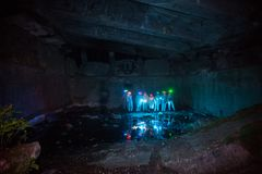 Diggers in the dungeon peoples udnerground journey. Cave dark Stock Photography