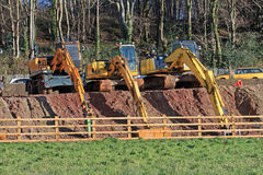 Diggers. Parked in a row Royalty Free Stock Photos
