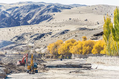 Diggers is ready to clean the riverway. In Dunhuang Royalty Free Stock Photos