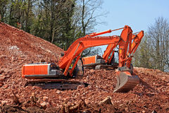 Diggers. On a road construction site Royalty Free Stock Images