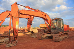 Diggers. On a road construction site Stock Image