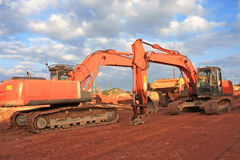 Diggers. On a road construction site Royalty Free Stock Image