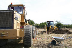 Digging. A excavator digging the base of a new building Royalty Free Stock Photo