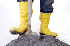 Digging. Construction worker is digging with a shovel Royalty Free Stock Photo