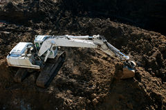 Digging. A excavator digging the base of a new building royalty free stock photos