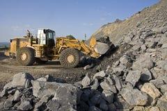 Digging. A excavator digging rock mine Stock Image