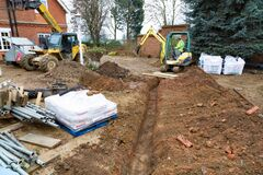 Free Digging A Trench For Drains, UK Building Site Royalty Free Stock Photos - 189225748