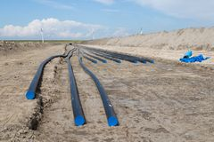 Digging of electricity cable trench for new windfarm Stock Photos