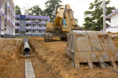 Digging drains to prevent flooding. Excavators were digging drains to prevent flooding Stock Image