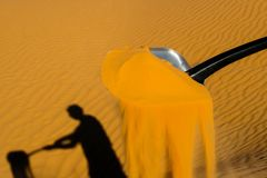 Digging on dune Stock Photography