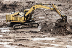 Digging excavator machine at building construction site Royalty Free Stock Photography