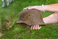 Digging in the forest. The German helmet M35. Imitation. WW2 recovery. Russia. stock image
