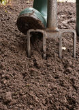 Digging the Garden. Gardener digging the earth over with a garden fork to cultivate the soil ready for planting in early spring Stock Image