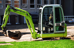 Digging machine. Small green industrial digging machine Royalty Free Stock Photography