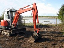 Digging out. For flood defences near a tidal river stock images