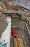 Digging for roadworks during the laying of a conduit for fiber o Stock Photography