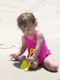 Digging in the sand Royalty Free Stock Image