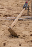Digging the soil with a hoe Royalty Free Stock Images
