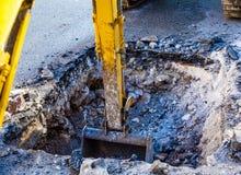Digging street city. Working Excavator Tractor Digging street city stock photos