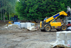 Digging Up the Park. A photograph of a building site with numerous examples of heavy machinery Stock Photos