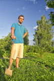 Digging a vegetable garden. Young man with a shovel digging a vegetable garden Royalty Free Stock Photo