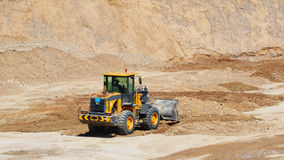 Digging work with front wheel loader. The excavation of pit of sand gravel soil with front wheel loader for new construction for buildings Royalty Free Stock Photo