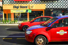 Digi Store. Kuala Lumpur, Malaysia - July 29, 2017; Digi Store photo taken while two taxi crossed through motion blurred in front of photographer Royalty Free Stock Photography