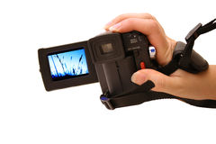Digicam. Hand holding digital video camera Royalty Free Stock Photography