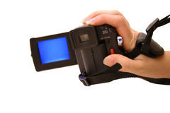 Digicam. Hand holding digital video camera Royalty Free Stock Photos