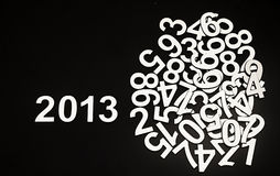 Digit 2013 and pile random numbers. On black background Royalty Free Stock Images