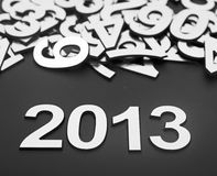Digit 2013 and pile random numbers. On black background Royalty Free Stock Photo