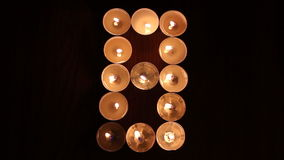Digit eight made of candles Stock Photo