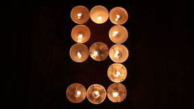 Digit nine made of candles Royalty Free Stock Photos