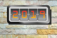 Digit Year clock on rock wall. Background stock images