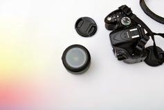 Digita SLR kamera med Lens och huvseprate Arkivfoto