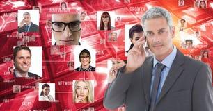 Digitaal geproduceerd beeld van zakenman die slimme telefoon met behulp van tegen portretten stock illustratie