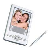 Digitaces PDA y aguja sobre blanco fotografía de archivo libre de regalías