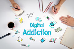 Digital Addiction Concept. The meeting at the white office table Royalty Free Stock Image