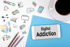 Digital Addiction. Mobile phone and coffee cup on a white office desk Royalty Free Stock Images