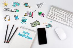 Digital Addiction. Office desk table with computer, Smartphone, note pad, pencils Stock Image